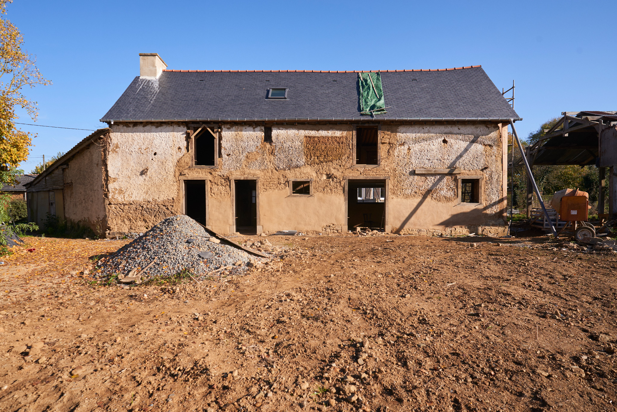 Reportage photo suivi de chantier maison terre